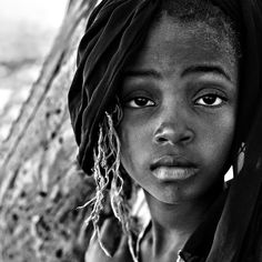 Gambia - There is too much life experience/understanding in this child's eyes.