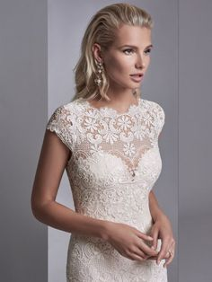 Sottero and Midgley - zayn rose, This boho wedding gown features allover lace motifs in a sheath silhouette, with sheer lace comprising the jewel over sweetheart neckline, cap-sleeves, and scoop back. Finished with covered buttons over zipper closure.