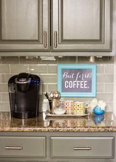 was looking at coffee bar setups but I like the cabinet color and backsplash :)