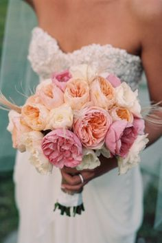 Bridesmaid bouquets: peach and coral peonies and garden roses, + dusty miller  - weird feathers