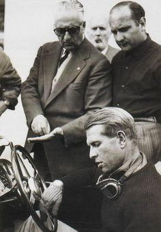 Enzo Ferrari, Fangio and Peter Collins.