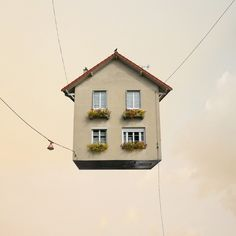 "Laurent Chehere, Paris based photographer, makes houses flying high. Reminding the famous ""Up!"" flying house, but without balloons, these photomanipulated series of buildings makes us dream, not just for the subjects, but also for the light of the scenes which contribute to create an unreal world."