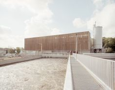 Water-treatment plant outside Paris remodelled by AWP to reveal its industrial processes to the public. Wood Architecture, Contemporary Architecture, Amazing Architecture, Prison, Habitat Collectif, Plant Pictures, Water Treatment, Urban, Plant Design