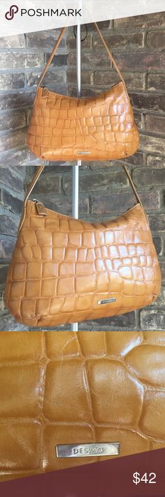 """Desmo Tan Leather Bag Handbag Vintage Purse Desmo Italian handbag tan leather hobo bag purse. Genuine croc embossed light brown leather, hobo style shoulder bag, inside zip pocket. Very good vintage condition, inside shows some makeup wear or dust, some wear to exterior corners and underside of strap, scrathing on logo hardware, please see photos.  Appropriate measurements Length 14"""" Height 9.5"""" Strap drop 10""""  h094 Desmo Bags Hobos"""