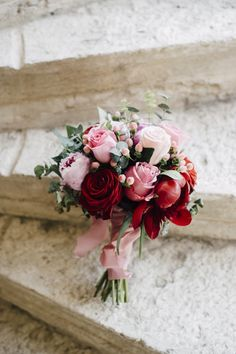 red and pink wedding rose bouquet
