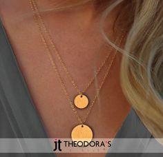 Handmade double coin necklace made from gold-plated silver on gold-plated silver chains 45cm and 50cm with silver clasp. A minimal but timeless choice!---------------------------------------------------Χειροποίητο διπλό κολιέ με δύο φλουριά από ασήμι επιχρυσωμένο με σαγρέ φινίρισμα σε αλυσίδες κρίκο κρίκο από επιχρυσωμένο ασήμι. Το ένα φλουρί έχει διάμετρο 17mm και κρέμεται σε αλυσίδα 45cm, ενώ το άλλο 20mm και κρέμεται κάτω από το μικρότερο σε αλυσίδα 50cm.