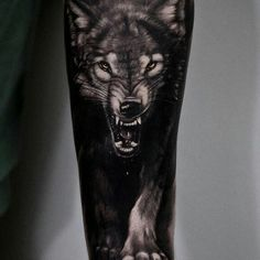 Black and grey realistic tattoo style of Wild Wolf motive done by artist Andrey Stepanov Wolf Tattoos Men, Bear Tattoos, Badass Tattoos, Animal Tattoos, Body Art Tattoos, Hand Tattoos, Tattoos For Guys, Tatoos, Wolf Sleeve