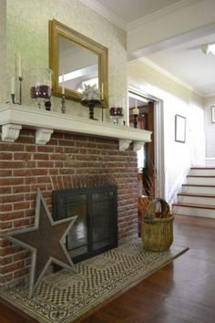 I like the brick front and white mantel on this fireplace, if only the actual fireplace insert was better looking