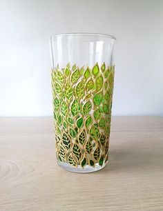 Water Glass Green ombre leaves glass tumbler Hand painted Floral Drinking Glasses nature inspired glassware This is a bright and positive water glass with hand painted cute leaves in green colors. It can make a unique gift for any occasion or to be a great decoration in your house and make
