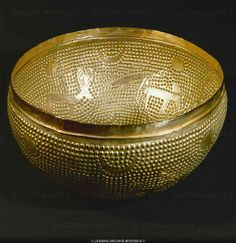 HALLSTATT CULTURE VESSEL 6TH BCE  Hemispheric gold bowl with bossy surface, spared-out suns, moon sickles, and animals from Zuerich-Altstetten, Switzerland Diameter 25 cm