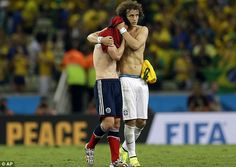 Hard to take: Brazil defender David Luiz consoles Rodriguez at the end of the match in For...