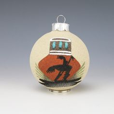Fabulous Christmas ball ornament with sand painting of end of the trail and Monument Valley. 3  1/4″ tall x 2  1/2″ wide x 2  1/2″ long