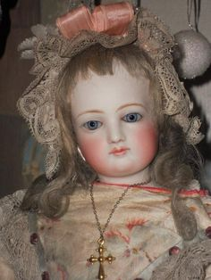 Wonderful all perfect fashion doll by Emile Jumeau ....... pale bisque poupee with beautiful rich eyes  which are an elegant contrast to her delicate