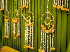 Leaf bird hangings for backdrop by the Doli diary-Mumbai. Wedding Backdrop Design, Wedding Hall Decorations, Backdrop Decorations, Backdrops, Housewarming Decorations, Wedding Mandap, Entrance Decor, Marigold, Heavenly