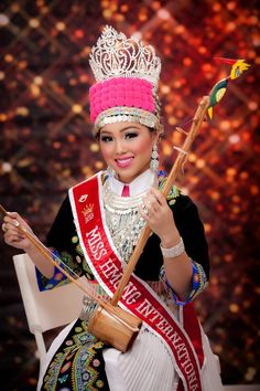 Miss Hmong International, Anna Vue is wearing a traditional white Hmong outfit.