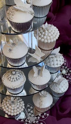 White vintage cupcakes in a tower #wedding #weddingcupcakes #white #cupcakes #cupcaketower