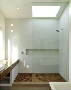 Recessed shelf and spa-like feel of wood shower tray