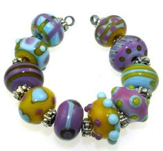 The beads are a combination of purple, yellow and sky blue. The colors react to one another for interesting effects