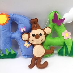 what a colourful & happy set of felt letters.  personalized name banners done in safari . Jungle theme