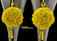 Golden Glamourpuss pom pom earrings  featuring handmade wool pom poms in shades…