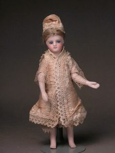 """French 5"""" all-bisque bare feet  Made by Sustrac in the early 1870's   BTE marking on the back"""