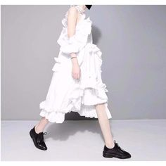 Alvarez Asymmetrical Ruffle Dress - White  ||  The Alvarez dress is one of our best sellers. It's puffy and ruffly with some ties and a hint of shoulder. We love this as an everyday dress. It's easy to throw https://www.mymallmetro.com/products/alvarez-asymmetrical-ruffle-dress-white?utm_campaign=crowdfire&utm_content=crowdfire&utm_medium=social&utm_source=pinterest