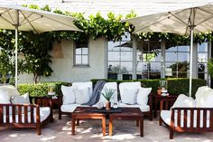 """For that organic look outside, Stansfield says you can never go wrong with wood, especially teak. """"Don't cheap out,"""" she says. """"If you're going to buy outdoor furniture and umbrellas you should invest; otherwise it'll be broken by the end of the summer."""""""