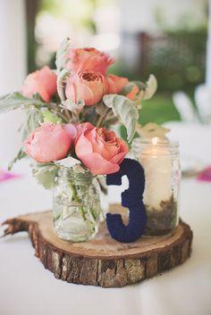 navy blue and blush pink wedding  centrepiece on wooden tree slice