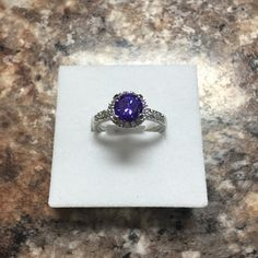 1.94ct Tanzanite Crown Ring A gorgeous tanzanite purple cubic zirconia gemstone set in lead free alloy (brass) with rhodium plating for a platinum finish Ocean Jewelers Jewelry Rings