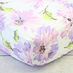 This purple floral crib sheet is too cute to not put on the crib in a purple nursery.