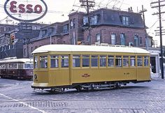 TTC Rail Grinding Car W-28 crossing Queen St. on Rondcesvalles. PCC 4393, a HUMBER QUEEN car watches on July 4, 1966 (23947175140) - Category:1966 in Toronto - Wikimedia Commons Toronto Subway, Toronto Ontario Canada, Light Rail, Busses, Local History, Back In Time, Wikimedia Commons, Trains, Cities