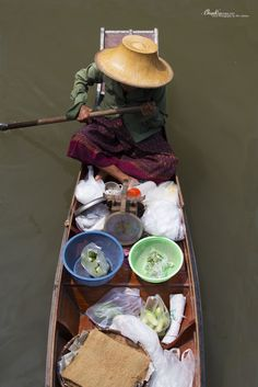 Lady working at the Amphawa floating market, Thailand