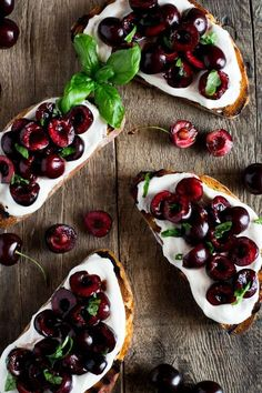 Whipped ricotta toast recipe with deep red, fresh cherries tossed in balsamic vinegar and scattered with some chopped basil leaves. Easy Italian appetizers at inside the rustic kitchen.
