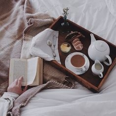 // breakfast in bed with book