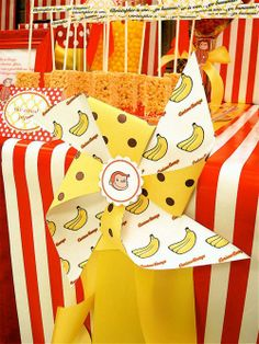 curious george monkey red yellow birthday party dessert table yellow banana pinwheel ribbon
