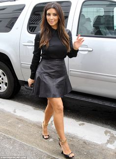 Leather look: Kim Kardashian shows off her figure in a flattering black leather outfit as she arrives at her Dash store in Miami. I need this outfit!