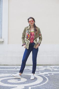 A colourful daytime look with a tie dye t shirt and an embellished parka