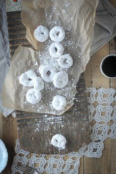 The best Gluten Free Vanilla and Powdered Sugar Donuts you will ever eat! They are easy to make and even easier to devour. {Beard and Bonnet}