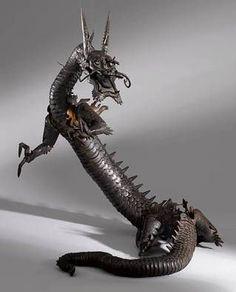 自在置物 Jizai Okimono from Edo period (1603~1868), Japan  - Jizai Okimono are realistically shaped figures of animals made from iron, copper. Their bodies and limbs are articulated, and can be moved like real animals. Dragon art sculpture