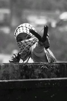 A Palestinian protester uses a slingshot as she takes cover behind a garbage bin during clashes between Palestinian stone-throwers and Israeli troops outside Ofer prison near the West Bank city of Ramallah June Story Inspiration, Character Inspiration, No Mans Land, Freedom Fighters, Slingshot, Cultura Pop, Post Apocalyptic, Photojournalism, Love Songs
