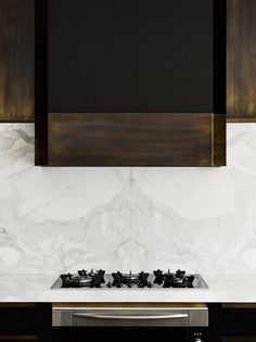 Kitchen hood in a Melbourne Residence by Flack Studio | Photo by Brooke Holm | Styling by Marsha Golmac