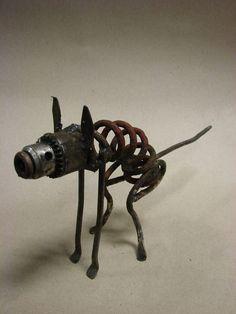 The dog Welded Art, Metal Art Sculpture, Arc Welding, Welding Table, Rock Path, Scrap Recycling, Metal Garden Art, Scrap Metal Art, Fire Bowls
