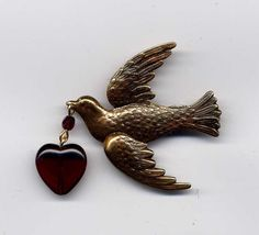 Valentine Flying Bird Pin with Deep Red Heart. Etsy.