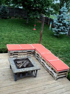 DIY Outdoor Pallet Sectional. Not loving the cushions but with a fun print and painted pallets <3