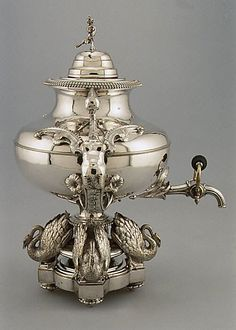 Tea Urn, 1845, French Silversmith P. B., Paris  Purveyor: F.A. Thouret Medium: Silver plate Dimensions: H. 15 1/2 in. (39.4 cm.); Gr. W. 13 1/4 in. (33.7 cm.) Accession Number: 1988.406 a-c The Metropolitan Museum of Art
