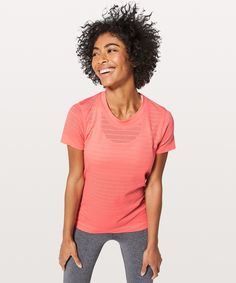 Breeze By Short Sleeve Squad - We designed this anti-stink,  short sleeve with open-hole  ventilation to keep you cool  during sweaty circuit classes  and indoor cycling sessions.