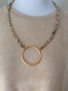 "Fun gold necklace! Love the gold circle. This one is 28"" long ($26.00)"