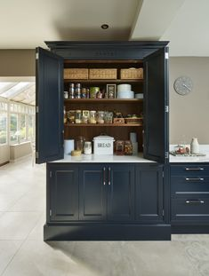With a rich heritage and distinctly British feel, the pantry has become something of a kitchen icon. Here are our favourite ways to plan a pantry or larder. Kitchen Larder Cupboard, Kitchen Pantry Design, Cupboard Design, Kitchen Tops, Kitchen Units, Home Decor Kitchen, Kitchen Interior, New Kitchen, Kitchen Ideas