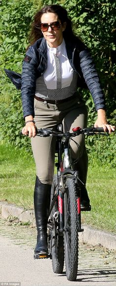 Chic: She wore a pair of skin tight jodhpurs, riding boots, a black and white shirt and a black helmet