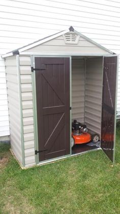 Store your lawn mower, sports equipment and patio furniture with the help of this Palram Tan SkyLight Shed. Wood Shed Plans, Shed Building Plans, Diy Shed Plans, Cool Sheds, Big Sheds, Shed Ramp, Polycarbonate Roof Panels, Garden Storage Shed, Storage Sheds